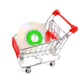 Mini CD in shopping cart isolated on white — Stock Photo