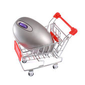Wireless computer mouse in shopping cart isolated on white — Stock Photo