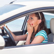 A scared woman is in the car — Stock Photo #13156151