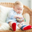 Boy is sitting on armchair — Stock Photo #25748821