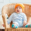 Boy is sitting on armchair — Stock Photo