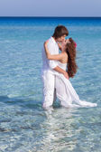 Just married couple in the sea — Stock Photo