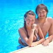 Couple in swimming pool — Stock Photo #33607423