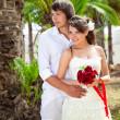 Bride and groom near palm-tree — Stock Photo