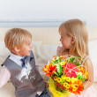 Boy is presented flowers to girl — Stock Photo