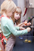 Boy and girl are cooking something — Stock Photo