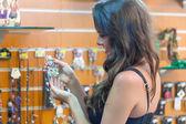 Woman is choosing jewerly — Stock Photo
