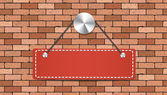Red label is holding on brick wall — Vettoriale Stock