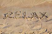 "Word ""Relax"" on the sand — Photo"