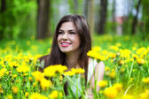Young woman is lying on field — Stock Photo