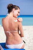 Woman is applying sunblock — Stock Photo
