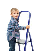 Boy is standing on ladder — Stock Photo