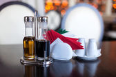 Napkins, olive oil and vinegar are on table — Stock Photo