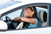 A scared woman is in the car — Stock Photo