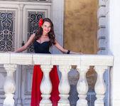 Spanish woman on the balcony — Stock Photo