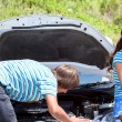 Man and woman near their broken car. — Stock Photo #51514119