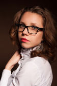 Portrait of a girl with glasses and red lipstick — Stock Photo