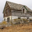 Abandoned farm house on prairie — Stock Photo #13821740
