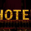 Stock Photo: Hotel sign lit up