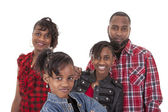 Pre-teen girl with her family — Stock Photo