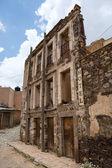 Abandoned crumbling hotel facade — Stock Photo