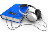Audiobook with headphones — Stock Photo
