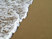 Ondas quebrando na praia — Foto Stock