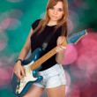 Teen rebellious girl playing electric guitar — Stock Photo