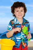 Adorable boy playing in the beach — Stock Photo