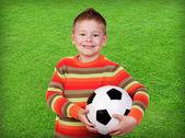 Student kindje met voetbal — Stockfoto