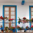 Nice balcony with blue doors - Stockfoto