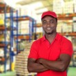 Foto Stock: Worker mwith red uniform