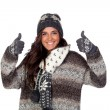 Beautiful girl dressed in winter clothing saying Ok - Lizenzfreies Foto