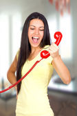 Casual Woman Shouting a Red Phone — Stock Photo