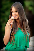 Attractive young woman eating ice-cream — Stock Photo