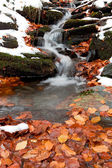 Snowy cascading water of a stream — Stock Photo