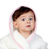 Surprised baby with bathrobe — Stock Photo