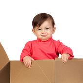 Adorable baby girl in a box — Stock Photo