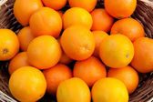 Basket full of oranges — Stock Photo