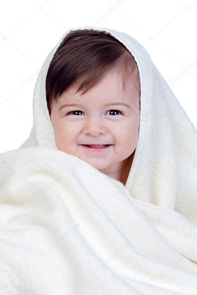 Happy baby covered with a towel isolated on white background  Stock Photo #16027693