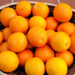 Basket full of oranges - Foto Stock