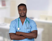 African american doctor with blue uniform — Stock Photo