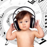 Adorable baby girl with big headphones — Stock Photo