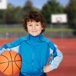 Adorable child playing the basketball — Stock Photo #18890399