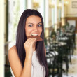 Young Girl Eating Chocolate - Foto Stock