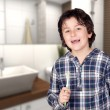 Stock Photo: Smiling child without toothbrush