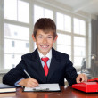 Little businessman in the office — Stock Photo