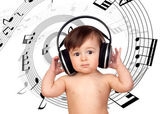 Adorable baby girl with big headphones — Stock Photo