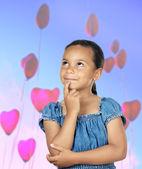 Adorable girl thinking — Stock Photo