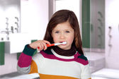 Pretty little girl brushing teeth — Stock Photo